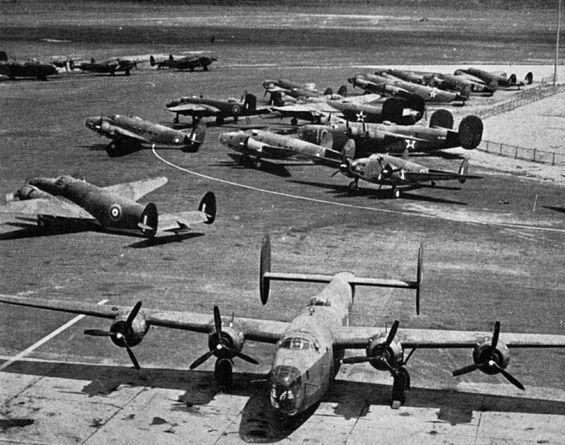 Photo: Aircraft at Dorval Airport awaiting delivery, a line of Hudsons behind the B-24 Lib parked in the front.